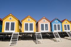 Colored Beach-houses. Beach-houses in Yellow, salmon and blue stock photos