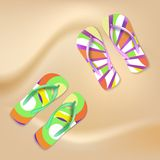 Colored beach slippers the sandy background Stock Photo