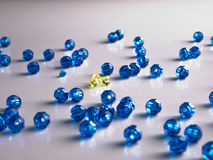 Colored Beads. Plastic Blue Colored Beads with a yellow standout Royalty Free Stock Photo