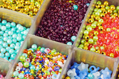 Colored beads in a box Stock Photo