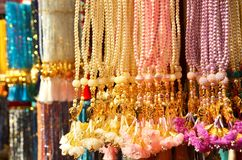 Colored beads hanging on a stand. royalty free stock images