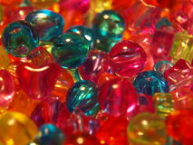 Colored beads in the shape of hearts, stars, balls Stock Photos