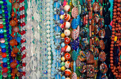 Colored beads showcase. Lot of colored beads from different minerals at the showcase Royalty Free Stock Photo