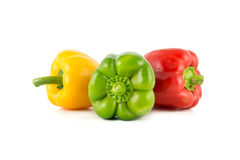 Colored bell peppers. Colour bell peppers isolated on white background Stock Images