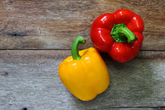 Colored bell peppers on wooden Royalty Free Stock Images