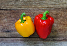 Colored bell peppers on wooden Stock Photo
