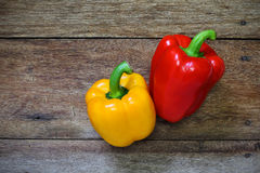 Colored bell peppers on wooden Stock Image
