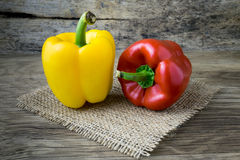 Colored bell peppers on wooden table Royalty Free Stock Image