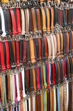 Colored belts gloves. Hanging multi-colored leather belts close-up. City Market of porcellino Florence royalty free stock photos