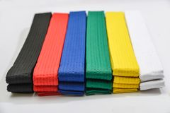 Colored belts in martial arts. For an almost gray background royalty free stock image