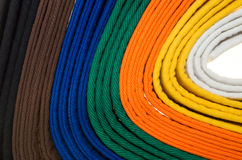 Colored belts in martial arts, and a part of judo uniform Royalty Free Stock Photo