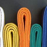 Colored belts. Martial arts colored belts from white to blue Royalty Free Stock Photos