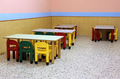 Colored benches and seats of a class of a preschool. Small colored benches and seats of a class of a preschool without children stock image