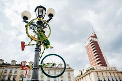 Colored bicycle is parked near a lamppost, a metaphor, an art object, a subculture Italy, Turin,. A colored bicycle is parked near a lamppost, a metaphor, an art Royalty Free Stock Photography