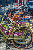 Colored bicycles parked in a european street. Royalty Free Stock Images