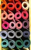 Colored big rolls of fabric in the shelf of the tailoring. Many colored big rolls of fabric in the rack of the tailoring for sale Royalty Free Stock Images