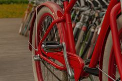 Colored bikes in a row stock photos