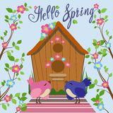 Colored bird near birdhouse in flat style. Vector illustration. Color illustration of birds in a flat style among the branches with leaves and flowers near a Royalty Free Stock Photo