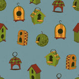Colored birdhouses on a blue background Royalty Free Stock Images