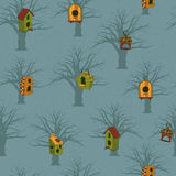 Colored birdhouses with trees on a blue background Stock Image