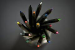 Colored black pencils. In jar stock photo