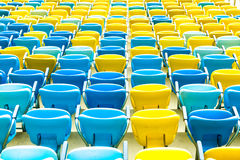 Colored blue and yellow seats Stock Image