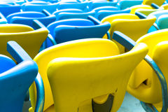 Colored blue and yellow seats Stock Photography