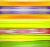 Colored, blurred matter horizontal stripes background. Abstraction of colored matter in stripes in yellow, green and blue tones. Background, texture Stock Photo
