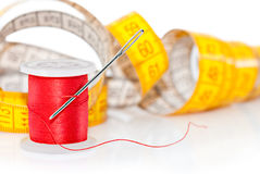 Colored bobbin and measuring tape Stock Images