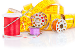 Colored bobbins and measuring tape Stock Image