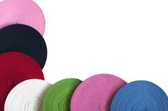 Colored bobbins of ribbons as framing Royalty Free Stock Image