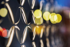 Colored bokeh effect on a glass architectural or science elements. Stock Image