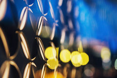 Colored bokeh effect on a glass architectural or science elements. Stock Photos