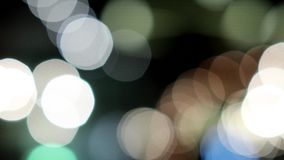 Colored bokeh. Moving blurry bokeh against a black background stock video footage