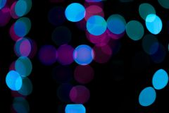 Abstract colored bokeh textures. Colored bokeh textures - abstract photo on the black background for adding and editing as the background layer in the multiply royalty free stock photo