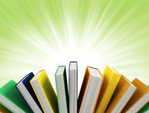 Colored books isolated on green Royalty Free Stock Images