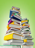 Colored books isolated on green Stock Images