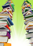 Colored books isolated on green Royalty Free Stock Photo
