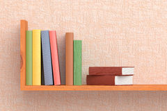 Colored books on wooden bookshelf on the wall. With pink wallpaper 3D illustration Stock Image