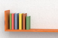 Colored books on wooden bookshelf. On the wall with white wallpaper 3D illustration Stock Photo