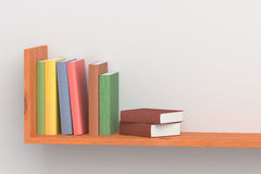 Colored books on wooden bookshelf on white wall Stock Photos