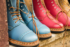 Colored boots background Royalty Free Stock Photography