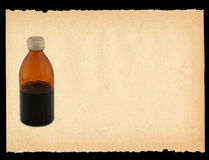 Colored bottle on paper Stock Images