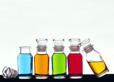 Colored Bottles. Apothecary bottles with colored liquid stock image