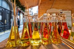 Bottles of fragrances with sticks for the fragrance of the house. Colored bottles of fragrances with sticks for the fragrance of the house Stock Image