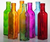 Colored bottles and their transparency. The transparency of seven colored bottles produce some new pastel colors that seem to come out of the brush of a painter Royalty Free Stock Photography