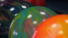 Colored bowling balls in the bollmachine. Сamera stock video