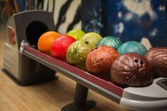 Colored bowling balls. Games and entertainment with friends. Royalty Free Stock Image