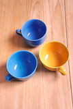 Colored bowls on table Royalty Free Stock Image