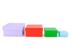 Colored boxes. Stacked colored packaging boxes isolated on white background stock images